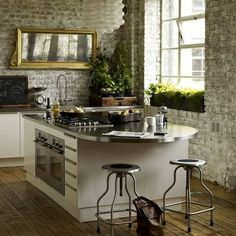 Love the feel of this kitchen!! Whitewashed brick, window, floors, countertop, vintage picture, Yellow flowers in the window..... Adjustable height stools :) Brick Wall Kitchen, Loft Kitchen, Kitchen Island, Stone Kitchen, Urban Kitchen, Kitchen Modern, Kitchen Backsplash, Modern Kitchens, Backsplash Ideas