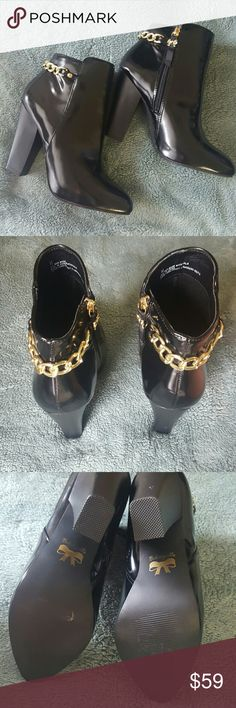"NWOT Betsey Johnson Betseyville Black Jolt Boots Betseyville black embellished faux leather ankle boots.  Cute little jeweled chain wraps around the back of the ankle and ends with a bow zipper on the inside. These shoes have never been worn and are in pristine condition.  Heel height- 4""  Offers always welcome! Betsey Johnson Shoes Ankle Boots & Booties"