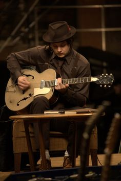 A Brief History Of Jack White's Guitar Collection... like the way Jack's knee makes the body shape appear different