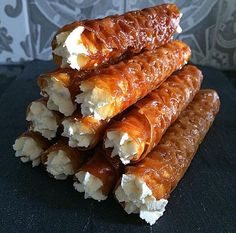 This technical challenge can be difficult for several reasons. The brandy snaps contain a lot of sugar which means they can easily burn. Another problem you may face is the rolling up part, you have to set the brandy snaps to cool slightly so they are still pliable, if you wait too long they