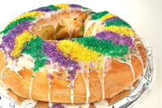 INTRODUCTION Serving a King Cake during Mardi Gras celebrations is a tradition that honors the Magi who visited the Christ child on the twelfth night or Epiphany (January 6). The cake is shaped in a ring with a pecan, bean or plastic baby placed inside the dough, before baking, to represent the baby Jesus. The cake is then decorated with the purple, green and gold colors of Mardi Gras, and divided among guests. Whoever finds the baby doll will host the next King Cake celebration.