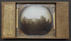 Lantern slide photograph on glass in wood mount, William Langenheim (1897-1874) and Frederick Langenheim (1809-1879), Philadelphia, 1850. The earliest known photograph of the Smithsonian Castle being built in Washington, D.C.