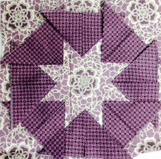 New method of making folded star blocks.  Sew around the sides of the prairie points to create a star hot pad.
