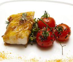 habanero cajeta-glazed black cod with macadamia nuts, tomatoes, and greens