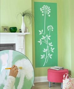 A crisply stenciled panel can add architectural character to a plain wall—and an extra shot of color and pattern.