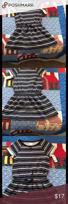 NWT Girls Dress This OshKosh Navy and Tan dress would be adorable over tights or leggings!  Made out of %60 cotton, 40% polyester French Terry, it is a perfect school dress for any season! Osh Kosh Dresses Casual