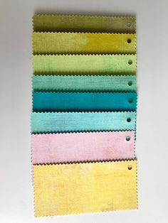 All fabrics are Moda Grunge, colors from up to down: 30150 97 Kelp, 30150 66 Decadent, 30150 303 Key Lime, 30150 154 Aqua, 30150 228 Ocean, 30150 226 Pool, 30150 64 Duchesse and 30150 281 Sunflower.