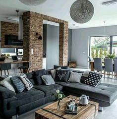 Rompe con lo cotidiano y mezcla el estilo rustico de los revestimientos con mobiliario moderno. #sofa #lamparas Ve mas #ideas para #remodelar en: arquitecturacreativa.blogspot.com Siguenos también...
