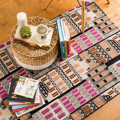 Make Over Your Living Room With This Cheap Easy Rug Hack - well, I certainly have enough fabric, plus I have a big rug mat...