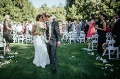 Matt Shumate Photography at Lawson Gardens outdoor summer wedding ceremony bride and groom kiss after being just married recessional