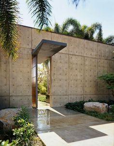 architectural concrete facade with cantilevered and lighted steel canopy.