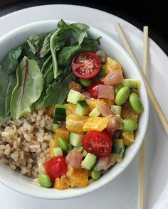 This brown rice albacore chirashi bowl recipe is to die for. Mixed greens and brown rice combine with juicy oranges, protein-packed albacore tuna, and fresh grape tomatoes in one healthy, refreshing meal.