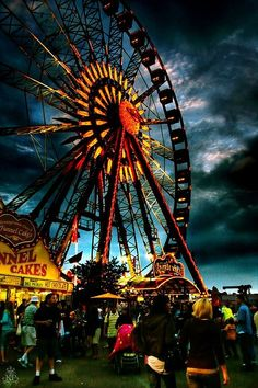 """""""Dark Carnival"""" Ominous and imposing storm clouds gather over the Ferris wheel at dusk. I have no idea who took the original photo, or who edited and manipulated the image to turn this into a piece of art, but it's cool as hell. Josie Loves, Carrousel, Carnival Rides, Creepy Carnival, Carnival Food, Night Circus, Fun Fair, Belle Photo, Pretty Pictures"""