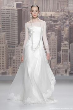 Rosa Clará 2015 drop-waist strapless bodice bridal gown with illusion neckline and long lace sleeves. (Rosa Clará Bridal Collection at Barcelona Bridal Week