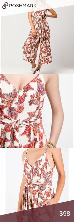 NWT Free People hot tropics jumpsuit in cream Adorable and super comfy FREE PEOPLE hot tropics jumpsuit in cream and orange with exotic print. V neckline, adjustable spaghetti straps, shell button front closure and a tie waist. Off seam side pockets and a patch pocket in the back. Relaxed fit with a wide leg cropped at the ankle. Lined to below the hips and brand new with tags still attached. This is a summer must have. Get it while you can. Free People Pants Jumpsuits & Rompers