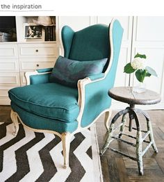 teal wingback chair, zigzag rug, industrial stool/side table