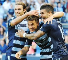 Sporting KC's Krisztian Nemeth (center) gets his hair ruffled by teammate Graham Zusi (left) as they and Dominic Dwyer (right) celebrate the first goal of the game, made by Nemeth, against the Colorado Rapids Saturday evening, June 27, 2015, at Sporting Park.