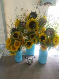 Turquoise mason jars with sunflowers are used for centerpieces on the buffet table. Photo picks of the graduate are added for a personal touch.