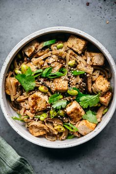 Vegan rice noodles with crispy pan-fried tofu, shiitake mushrooms, edamame and a spicy, umami sesame glaze. Such a flavorful one-pan dinner! #onepandinner #onepanrecipe #crispytofu #ricenoodles #vegandinner #tofurecipes #veganrecipes #easydinner | crowdedkitchen.com