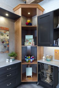 Fill that extra corner space up with this corner tall cabinet! The open shelving allow you to display your work of art for guest to see! #KBIS2016