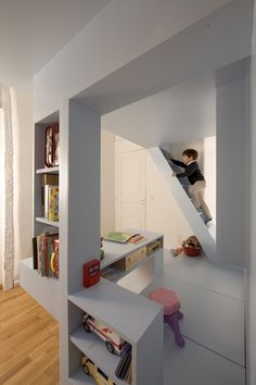 Children's Space Design - h2o Architects came up with a unique and aesthetically pleasing solution. They developed a unit, which essentially splits the room in two areas (one for each of the children) and makes use of height of the room to gain space and maximize function. Using geometric shapes, platforms and supporting beams the unit has it all.