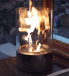 Nu-Flame Accenda - Cylinder Table Top Ethanol Fireplace With Glass Walls The perfect accent to any table, in any setting. This portable tabletop fireplace features a polished stainless stee
