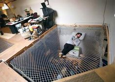 They say a 20 minute power nap is great for creativity. What better place to power nap than in a giant, comfortable net? Located inside an actual office, this bed was designed to look like a giant net (or spiderweb) overlooking the bottom floor.