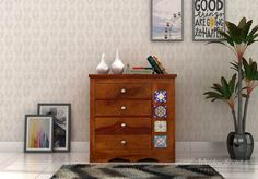 Discover unique, handcrafted #chestofdrawer inspired by the traditional Indian furniture. Inscribed tiles giving a fresh look to any corner it will be kept and sturdy look by #sheesham usage and #honeyfinish.  #bedroomcabinets #cabinets #storage #livingroomfurniture #homefurniture  See it yourself: https://goo.gl/CYy5Ac