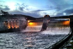 Pitlochry Hydro-Electric dam in full flow after a spell of very wet weather in Perthshire. -- I believe this is what Diana based Loch Errochty on in An Echo in the Bone