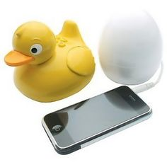 Plug your phone into the egg, then take the duck into the shower with you and listen to your music. May I have this? showers, music, eggs, gadget, speaker, bathtub, ipod, ducks, thing