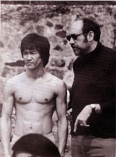 Bruce Lee Lived: Nov 1940 - Jul 1973 (age with the director of Enter the Dragon Robert Close On set.