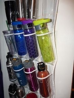 to Keep water bottles and travel mugs from falling out of your cabinets.  You can get the plastic storage shoe bags usually at dollar tree