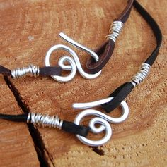 Wire closures - Silver. Aluminum. Deerskin. Leather. Cord. 18 inches.. $10.00, via Etsy.