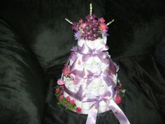 A diaper cake I made as a gift for my sister's baby shower. Pretty cool eh? It was my first attempt. Very easy to make!
