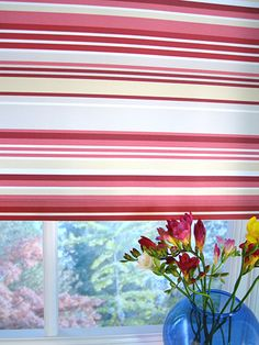 Bright pink tones are contrasted beautifully against the white and cream stripes, really brining this blind to life. #striped #roller #blinds