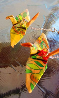 Handcrafted origami crane earrings red, orange, yellow and green. $15.00, via Etsy.