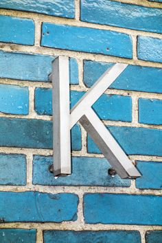 K on blue brick Letter N Words, Letter K Font, Alpha Letter, Alphabet Signs, Pink And Green, Blue And White, Alphabet Photography, Typography, Lettering