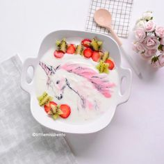 Needing some magic now 🦄 unicorn yogurt art.  Made with all natural ingredients for a healthy beautiful morning. Illustration is made freehand using yogurt blended with strawberries and mixed with bamboo charcoal powder.  Do you like this pink unicorn?