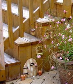 Fairy door on the side panel of the deck steps