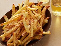 Warning: Oven Baked Parmesan Fries are extremely addictive! Oven Baked Parmesan French Fries recipe from Michael Chiarello via Food Network Healthy Side Dishes, Side Dish Recipes, New Recipes, Cooking Recipes, Favorite Recipes, Recipies, Potato Dishes, Food Dishes, Vegetable Dishes