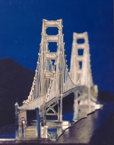 one of two identical silver long models of the golden gate bridge Tower Bridge, Golden Gate Bridge, Craft, Metal, San Francisco, Models, Inspiration, Beautiful, Silver