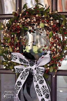 I would probably do this ribbon-less, but I love the greenery and berries!