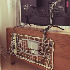 Keep wires from entertainment console tidy