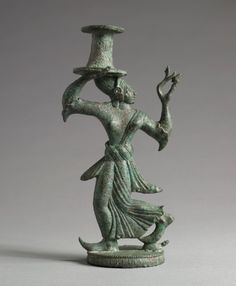Candelabrum Stand of a Dancing Maenad | Cleveland Museum of Art. Italy, Etruscan, late 6th Century BC. bronze, Overall - h:18.80 cm (h:7 3/8 inches). Purchase from the J. H. Wade Fund 1953.124