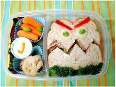Grouchy Bento.  Now how to keep the facial features on the sammy when my son swings his lunchbox in massive revolutions??