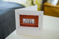 This beautifully photographed street sign has been turned into a unique and unforgettable greetings card. Kirk Street in Manchester makes a