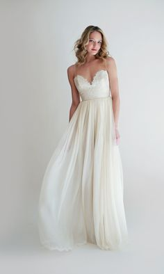 The Lucinda Dress is an Ivory french lace sweetheart gown with spaghetti straps and a chiffon skirt.
