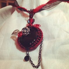 BLACKROSECHRIS Goth red and black wire wrapped glass pendant