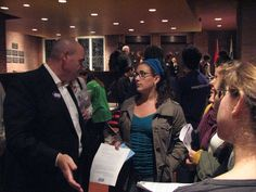 Food Forward members discussing Mayoral Candidate George Smitherman's good food policy after the Environmental Debate. Fall 2010.