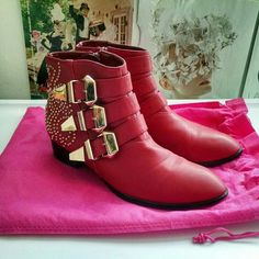 F21 Red Studded Faux Leather Ankle Boots Forever 21 red faux leather ankle boots with gold studded pattern and buckles. Used, with a few small scuffs. Amazing dupe for the famous Chloe Susan boots! Forever 21 Shoes Ankle Boots & Booties